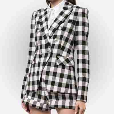 Emily Cooper's (Lily Collins) black and white checkered blazer from Emily in Paris