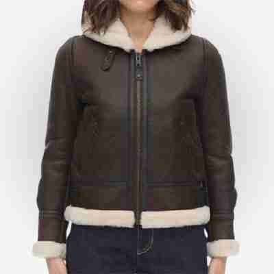 Women's dark brown hooded fur jacket from the front