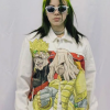 Billie Eilish wearing a white denim jacket with dio brando printed on the front