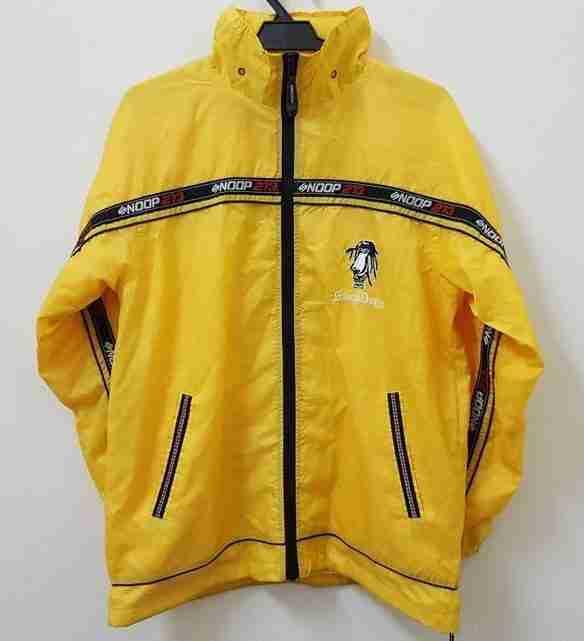 Front of vintage 90s Snoop Dogg yellow nylon jacket