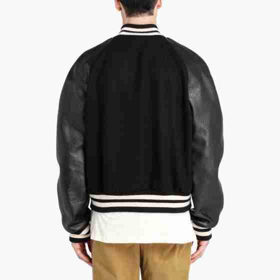 Back of men's black leather sleeved varsity jacket