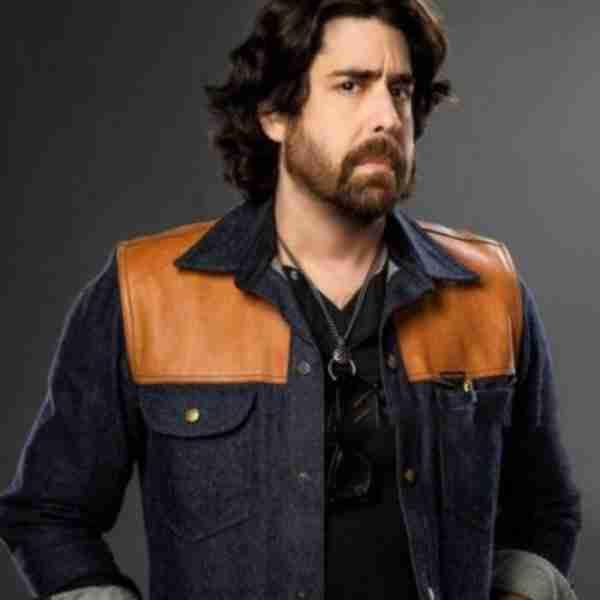 Adam Goldberg as Harry Keshegian from The Equalizer 2021 wearing a denim jacket
