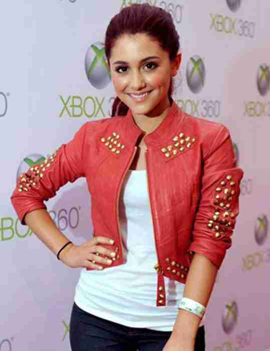 Ariana Grande wearing a red studded cropped leather jacket