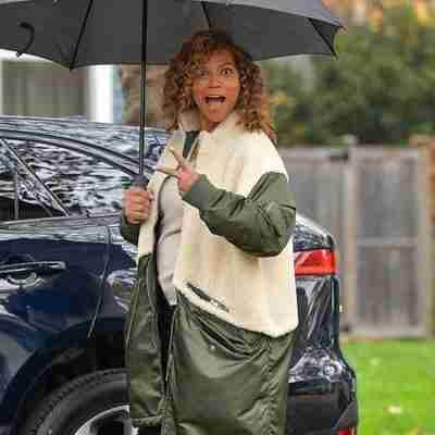 Queen Latifah seen on the set of The Equalizer (2021) wearing a green and white coat
