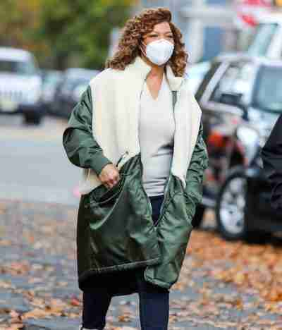 Queen Latifah (Robyn McCall) wearing a green and white coat on the set of The Equalizer 2021
