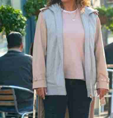 Queen Latifah on the set of The Equalizer (2021) as Robyn McCall wearing a beige tail coat