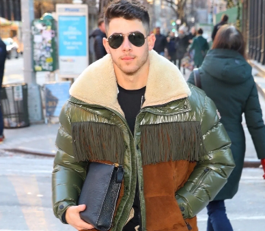 Nick Jonas Green puffer jacket