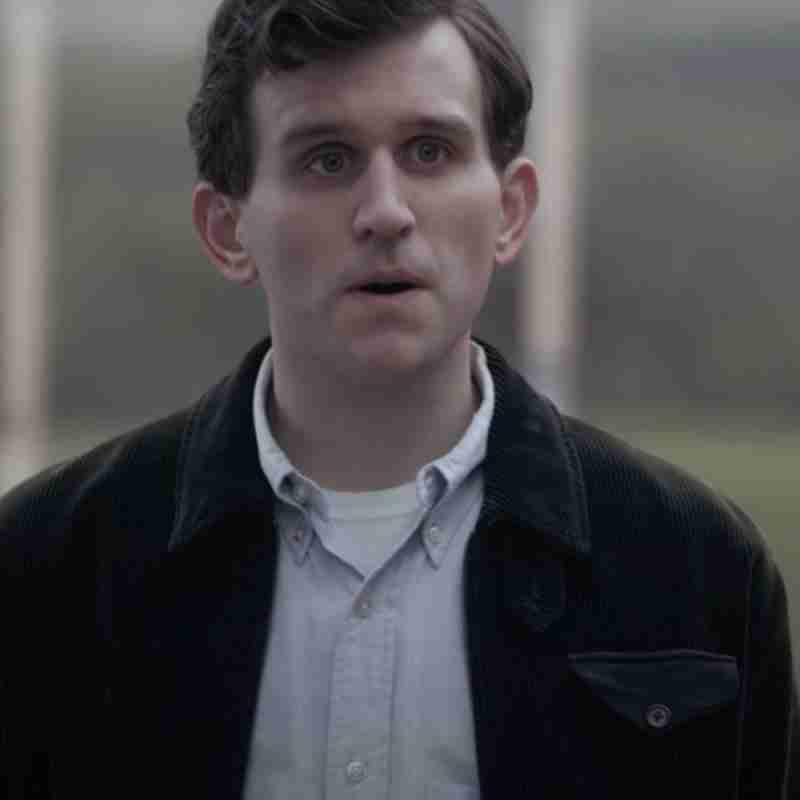 Harry Melling as Harry Beltik from The Queen's Gambit wearing a black corduroy jacket