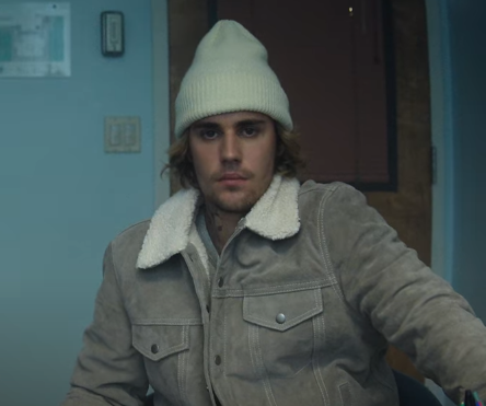 Justin Bieber wearing a shearling collar suede leather jacket in his Hold On music video