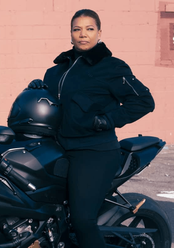 Queen Latifah as Robin McCall wearing a black zip-up jacket in The Equalizer 2021