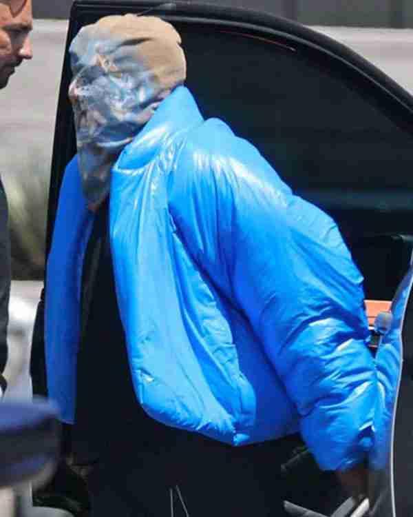 Kanye West wearing his Yeezy Gap blue round puffer jacket