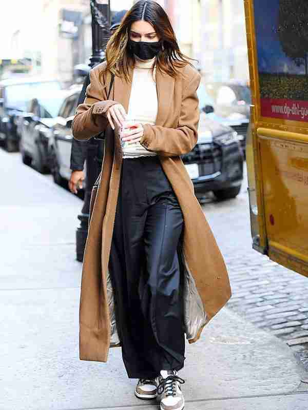 Kendall Jenner wearing a long woolen brown trench coat